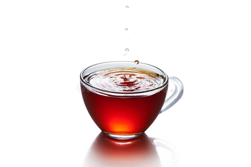 Cup of tea with splash isolated royalty free stock image