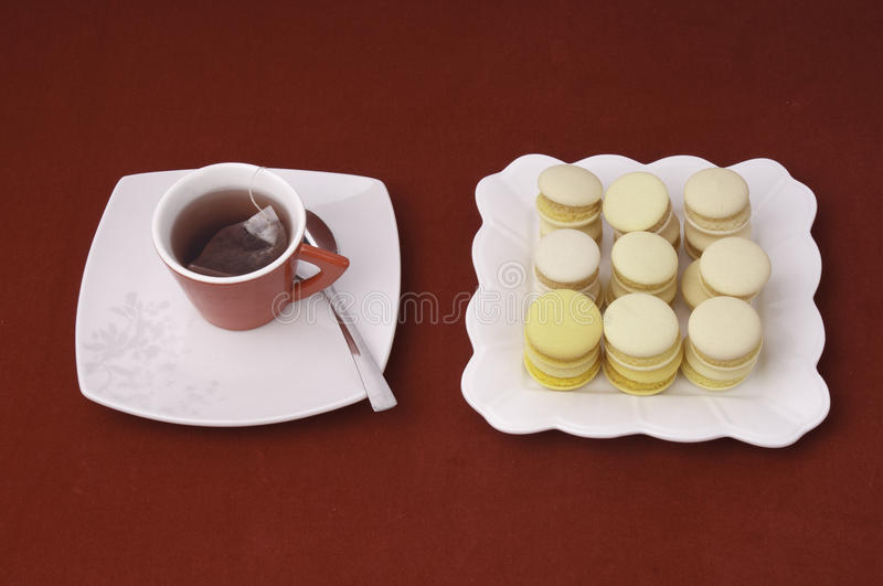 Cup Of Tea And Stacked And Aligned Macaroons Royalty Free Stock Photos
