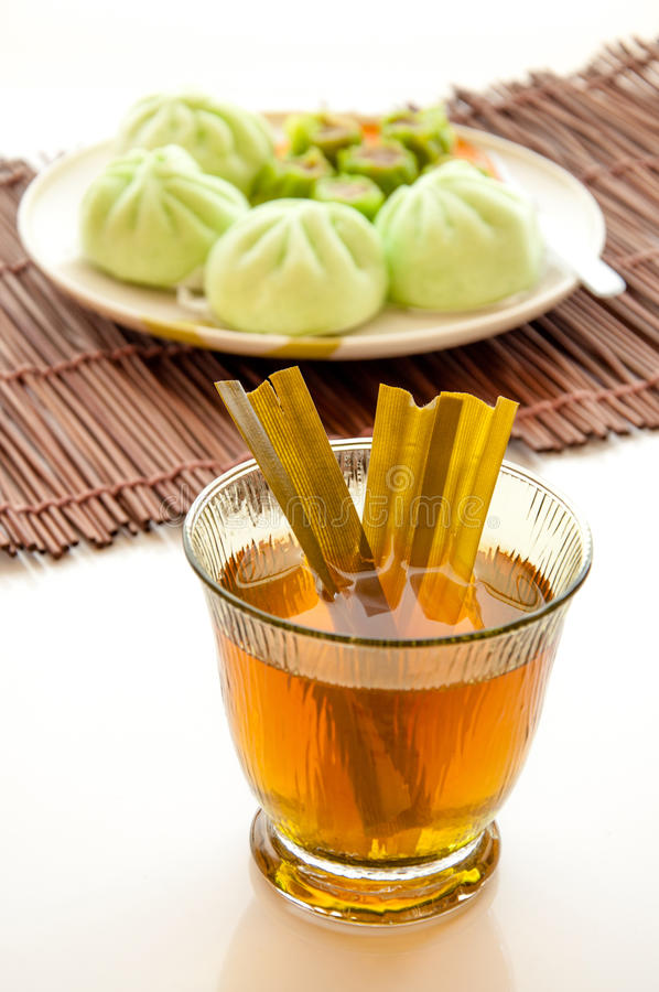 Cup of tea with steamed dumplings stock photography