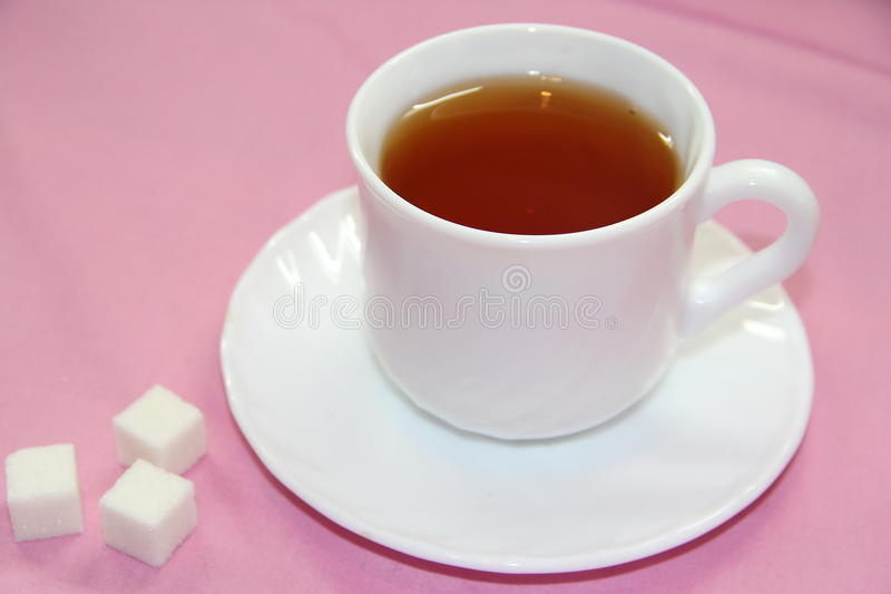 Cup of tea with sugar royalty free stock photos