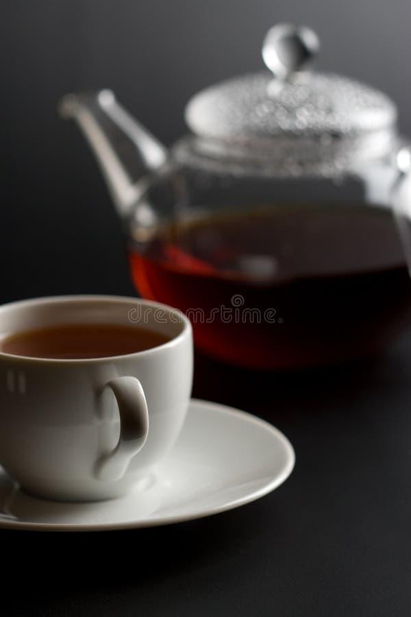 Cup of tea and tea pot stock images