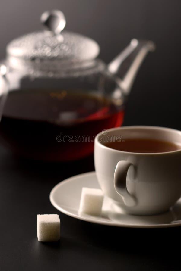 Cup of tea and tea pot stock photos