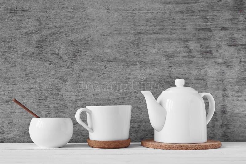 Cup of tea, teapot and sugar bowl royalty free stock image