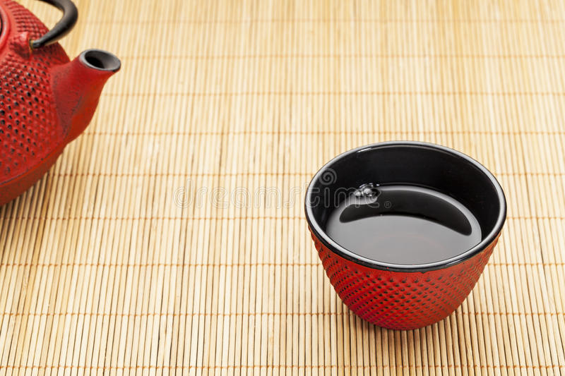 Cup of tea with tetsubin stock photography