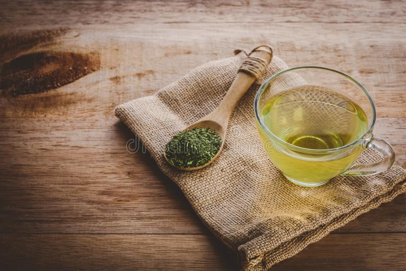 A cup of tea vintage tone. A cup of green tea and on sackcloth, vintage tone royalty free stock photos