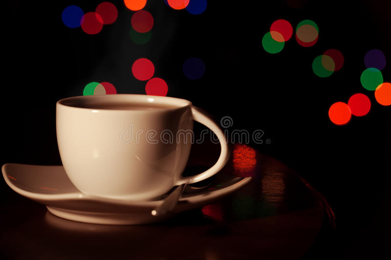 A cup of tea. A cup of warm tea before going to sleep stock image