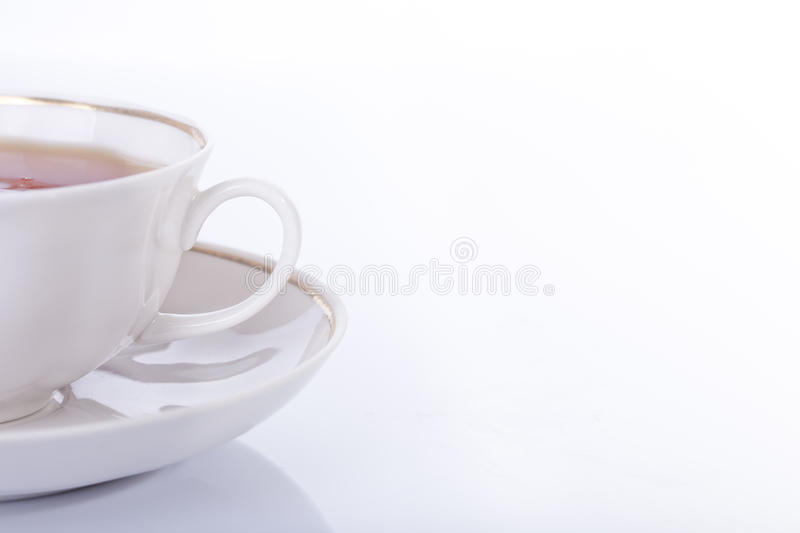 Cup with tea on a white background royalty free stock images