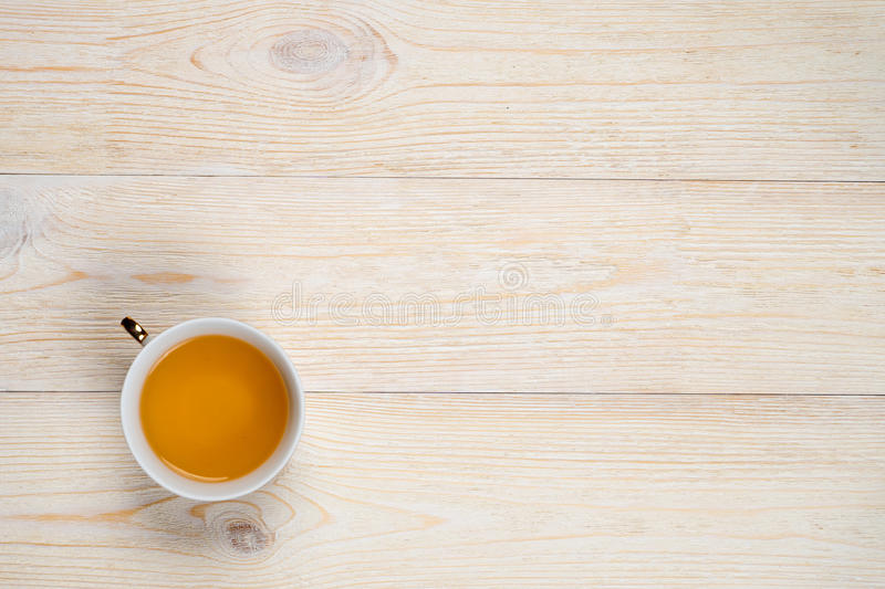 Cup of tea on wood with space royalty free stock image
