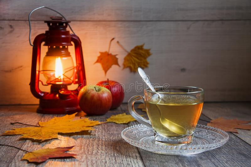 Cup of tea on wooden table with latern stock photos