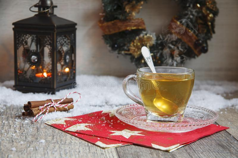Cup of tea on wooden table with latern royalty free stock photo