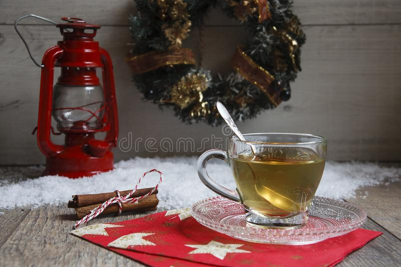 Cup of tea on wooden table with red latern royalty free stock images
