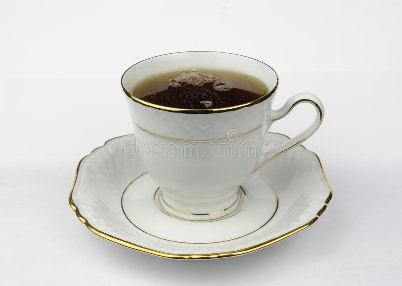Cup with Tee stock photography
