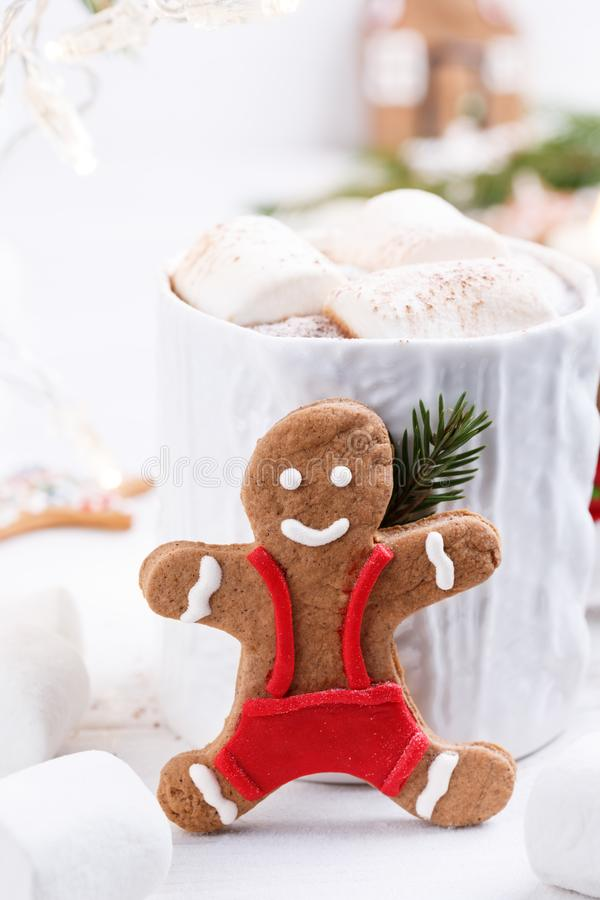 Cup of traditional hot chocolate with marshmallows and gingerbread on white table.  Christmas drink in New Year decorations.  royalty free stock photos