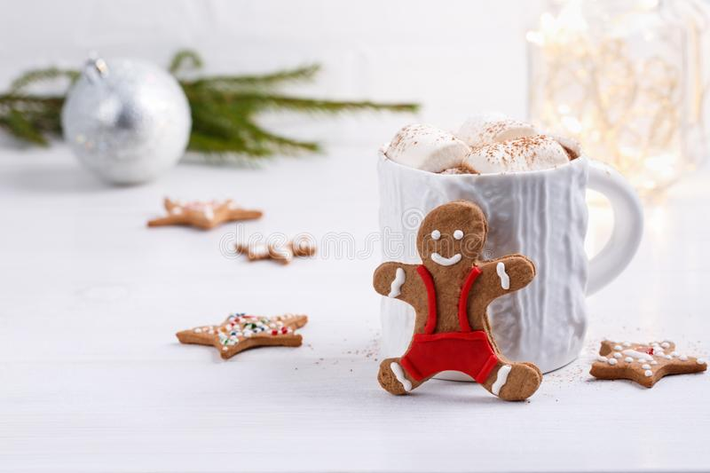 Cup of traditional hot chocolate with marshmallows and gingerbread on white table.  Christmas drink in New Year decorations. Copy space stock photography