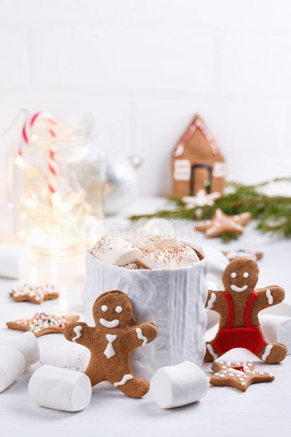 Cup of traditional hot chocolate with marshmallows and gingerbread on white table.  Christmas drink in New Year decorations. Copy space royalty free stock photo