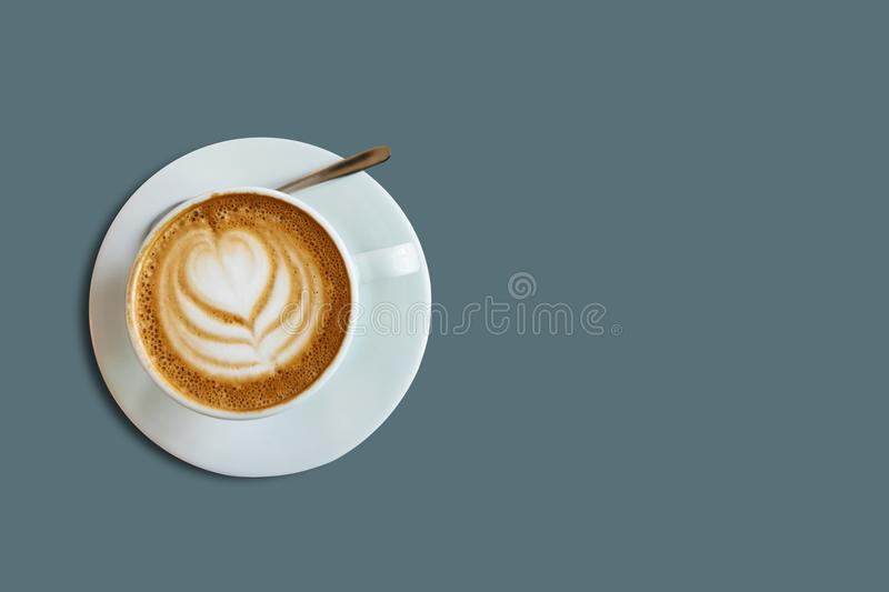 A cup with a traditional tasty and aromatic morning cappuccino royalty free stock photography