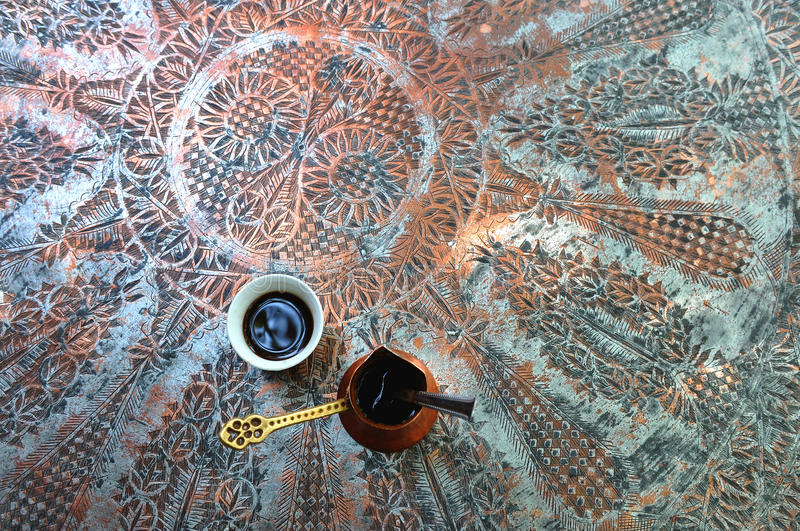 Cup of traditional Turkish coffee on brass table royalty free stock photos
