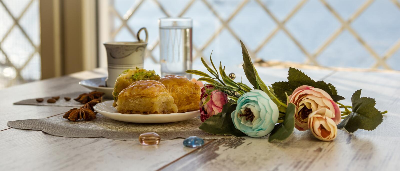 Cup of Turkish coffee and a plate with baklava royalty free stock photo