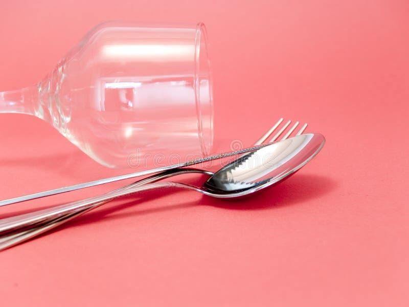 Cup und Tischbesteck lizenzfreie stockfotos