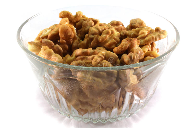 Cup of walnuts royalty free stock photos
