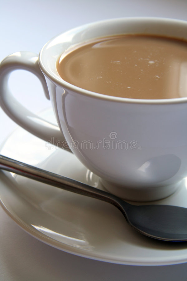 Cup of white coffee royalty free stock photography