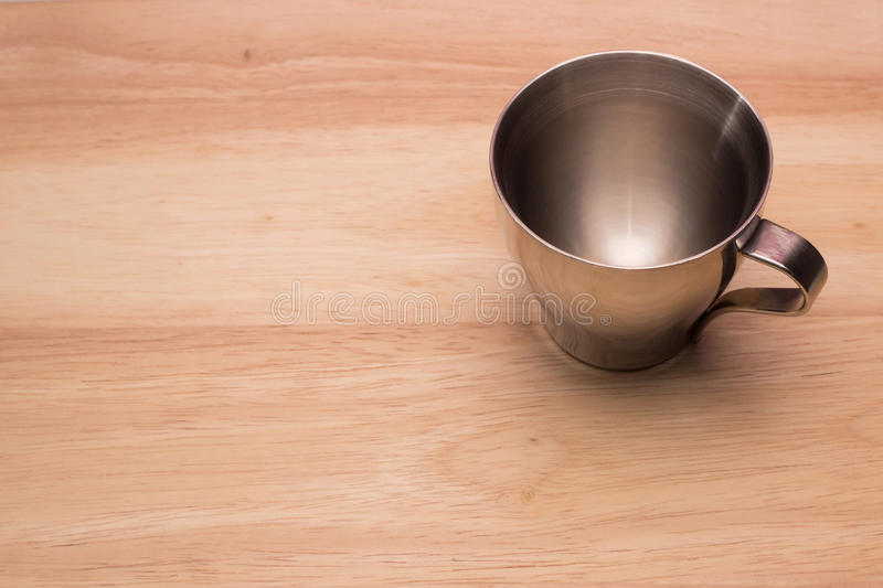 Cup on a wooden top royalty free stock image