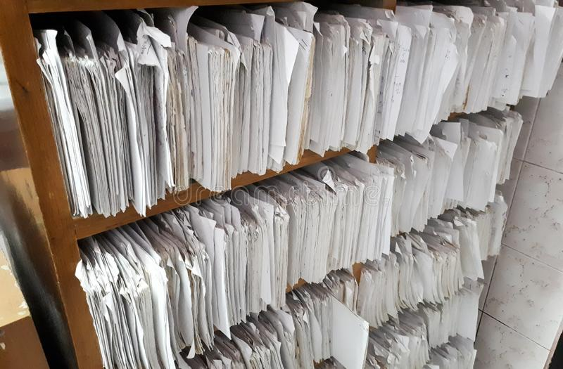 A cupboard full of paper files. / inefficiency of paper based filing system royalty free stock images