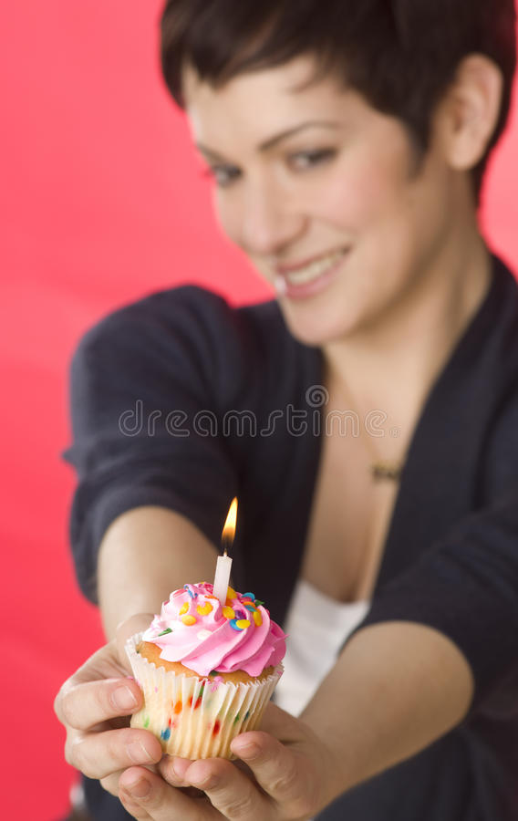 Pretty Woman Presents Pink One Candle Cupcake stock photography