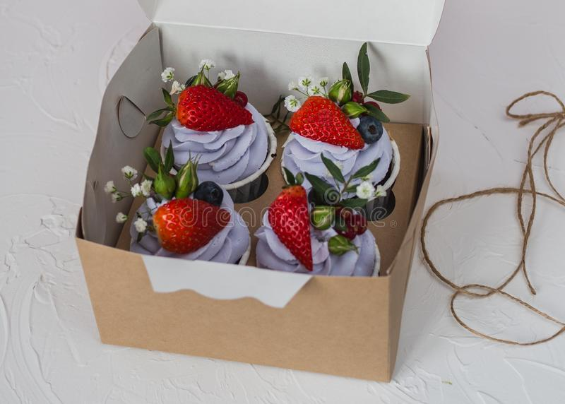 Cupcake with berries and mascarpone stock images