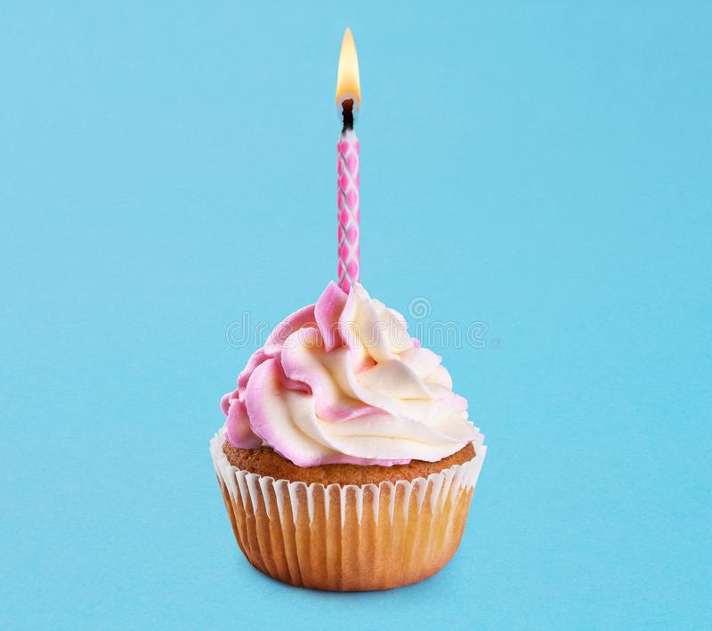 Cupcake with birthday candle. royalty free stock photos