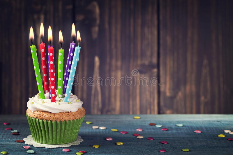 Cupcake with birthday candle royalty free stock photos