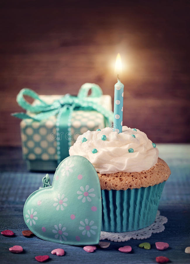 Cupcake with birthday candle stock photography