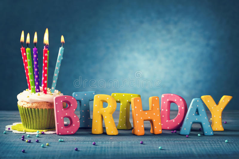 Cupcake with birthday candles stock photos