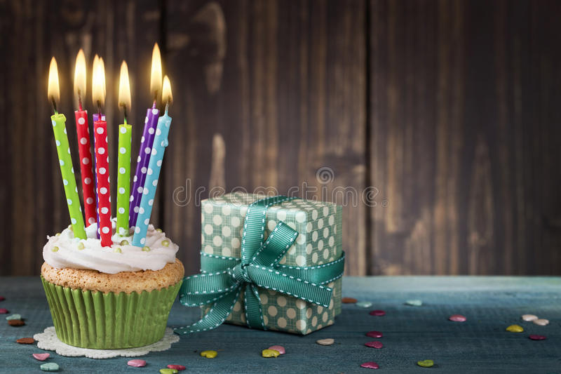 Cupcake with birthday candles stock images