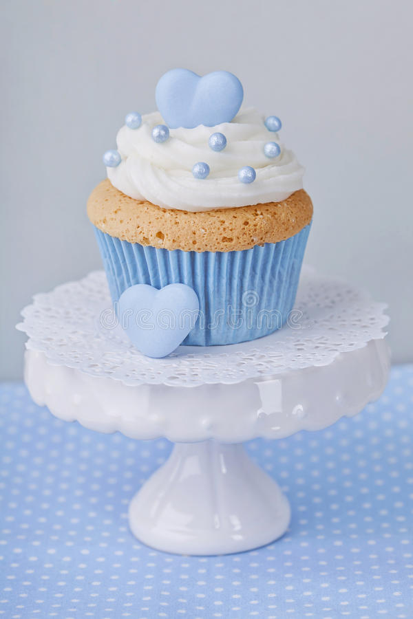 Cupcake with blue heart stock image
