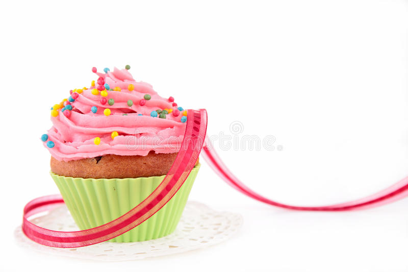 Cupcake. And bow isolated on white stock photos