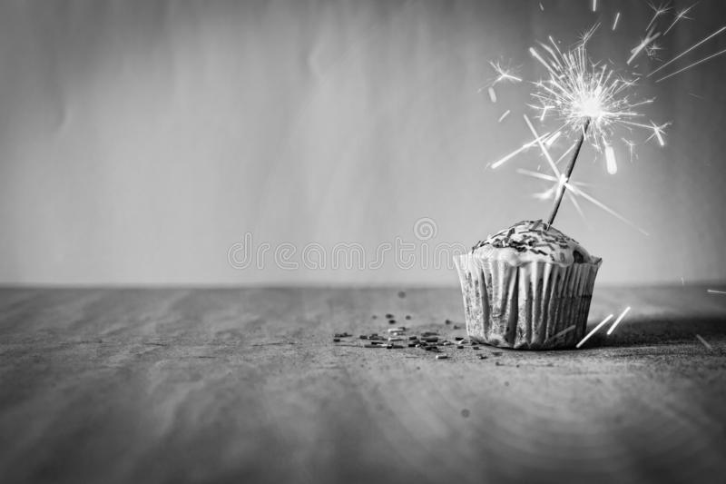 Cupcake, burning sparkler, congratulations, homemade, copy space royalty free stock image