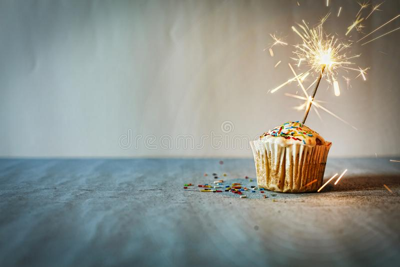 Cupcake, burning sparkler, congratulations, homemade, copy space royalty free stock photo