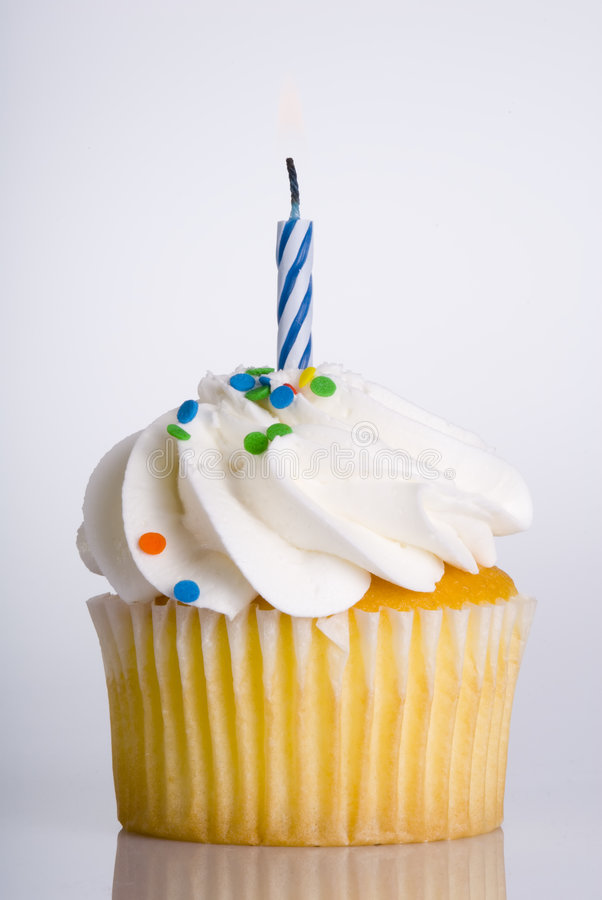 Cupcake with Candle. This image shows a festive cupcake with a single candle stock photos