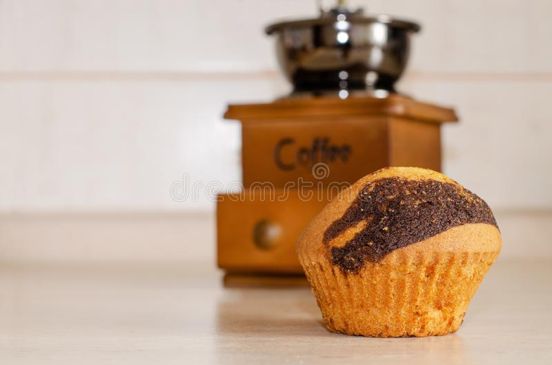 Cupcake with chocolate dousing on a wooden table royalty free stock photo