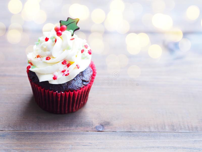 Cupcake with christmas tree shape on wooden table. stock images
