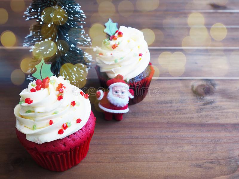 Cupcake with christmas tree shape on wooden table. Close up cupcake with christmas tree shape on wooden table. Christmas and new year holidays background concept royalty free stock photo