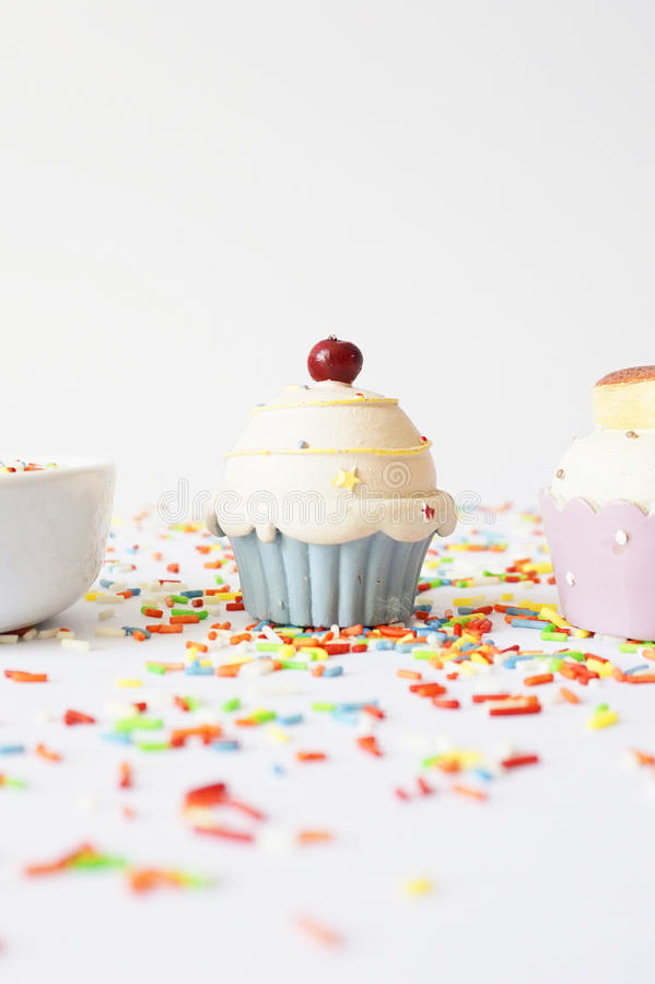 Cupcake and colorful sprinkle royalty free stock photos