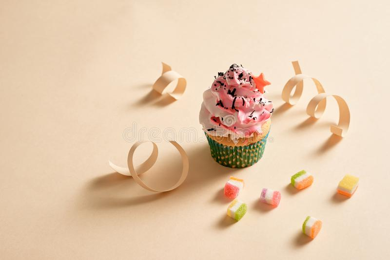 Cupcake, confetti background with copy space. royalty free stock photos