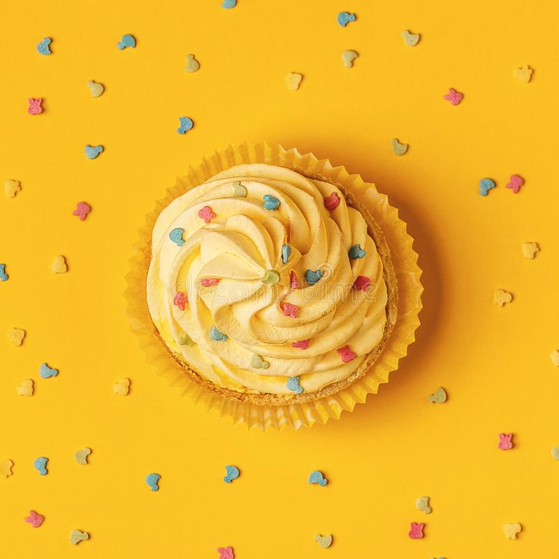 Cupcake, confetti background. royalty free stock image