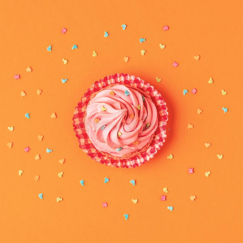 Cupcake, confetti background. stock photography