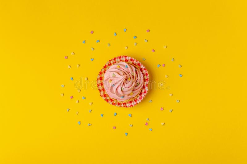 Cupcake, confetti background. royalty free stock images