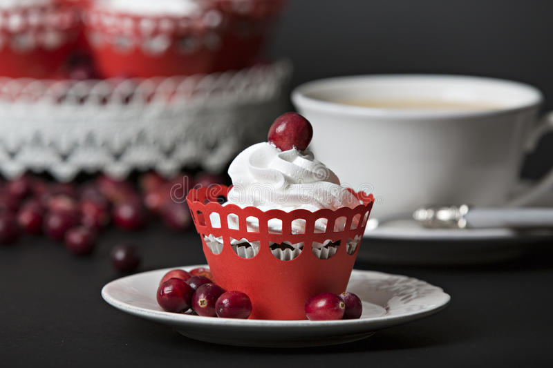 Cupcake with cream and cranberries royalty free stock photo
