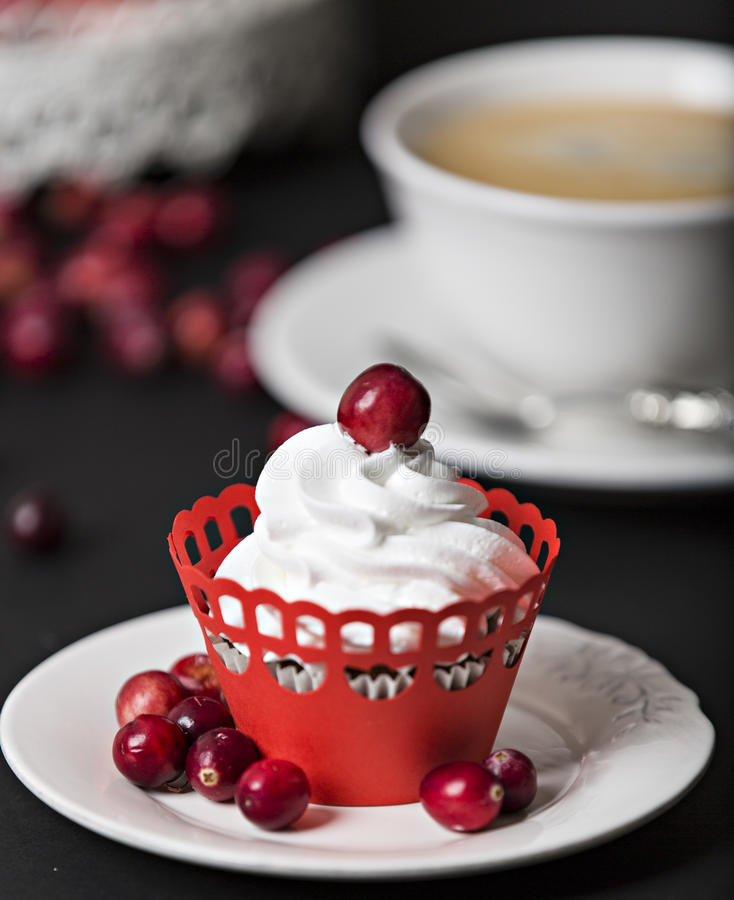 Cupcake with cream and cranberries stock photo