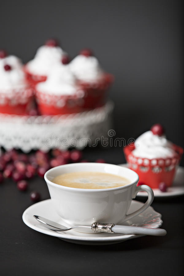 Cupcake with cream and cranberries stock images